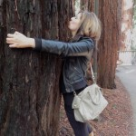 Santa Barbara Treehuggers International fan Giselle Brun gets fresh with a Santa Cruz Redwood.