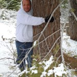 Jim Herrington warms up to Lodgepole pine along the trail at Lake Tahoe.