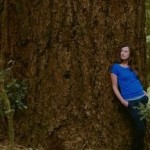 Cascadia Wildlands Executive Director Kate Ritley strikes a pose in the Elliott Rainforest, near Eugene, Oregon.