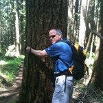 Marty Carr gets next to a Douglas fir on the Rattlesnake Mountain trail, near North Bend, Washington.